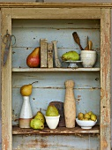 A display of pears in a wooden shelf