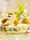 A cheese platter with crackers for Christmas dinner