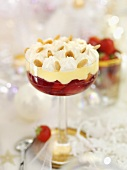Strawberry trifle with flaked almonds for Christmas dinner