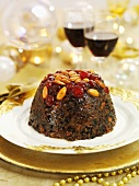 Christmas Pudding with almonds and glace cherries