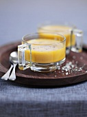 Carrot and Riesling soup in glass soup cups