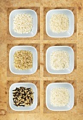 Various types of rice in bowls, seen from above