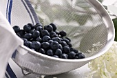 Wet blueberries in a sieve