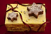 Chocolate stars on a golden gift box