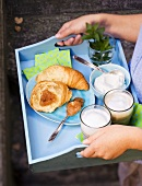 A tray with a croissant, gooseberry jam and coffee