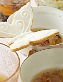 Tea cups with butterfly biscuits