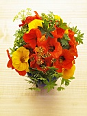 A bunch of herbs with nasturtiums