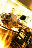 Leg of lamb on a spit in a restaurant