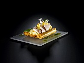 Rabbit with coconut and pineapple on a puff pastry boat