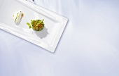 Herb blini with caviar and creme fraiche gnocchi (molecular gastronomy)