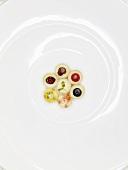 Fruit pralines and white chocolate (molecular gastronomy)