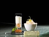 Citrus granita, milk foam, bay leaf as 'espresso' (molecular gastronomy)