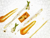 Asparagus pieces, pumpkin-quark pavé, potato powder (molecular gastronomy)