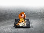 Norway lobster inversed in a salt crust with smoked carrots (molecular gastronomy)