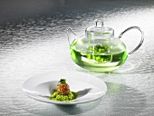 Pea soup as an infusion, pork knuckle praline (molecular gastronomy)
