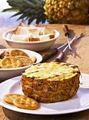 Pineapple with cheese fondue