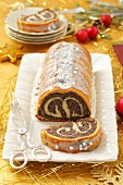 Christmas poppyseed strudel with icing sugar
