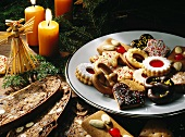 A plate of biscuits on a table laid for Christmas