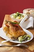 Roast chicken with ham under the skin with potato salad
