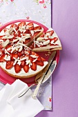 Quark cake with sliced strawberries and grated white chocolate