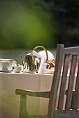 A table laid for breakfast in the garden (detail)