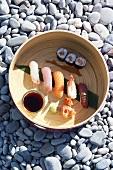 A sushi platter on gravel