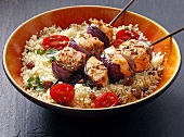Salmon kebab with caraway on a bed of couscous