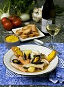 Bouillabaisse, bread and wine