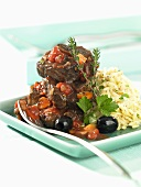 Short ribs with tomato sauce and olives