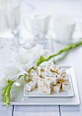 A gladiolus and white nougat with nuts