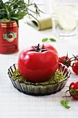 A tomato-shaped candle