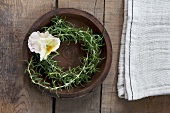 A rosemary wreath with a pansy