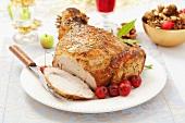 Roast pork with mini apples