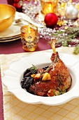 Roast goose leg with dried plums