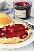 A bread roll spread with Dornfelder grape jam