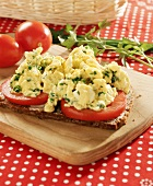 Wholemeal bread with sliced tomato and herb scrambled egg