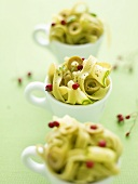 Tagliatelle with courgette, olives and rosehips in cups