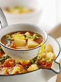 Vegetable soup with potatoes and tomatoes