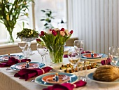 A festively decorated table with spring flowers