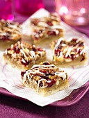 Pecan nut and cranberry slices with white chocolate glaze