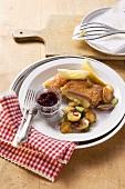Cordon bleu with cranberries and roast potatoes