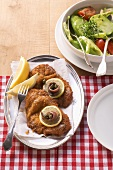 Viennese-style escalope with a mixed salad