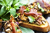 Toasted baguette with mushrooms and ham