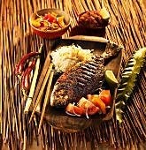 Marinated, grilled gilt-head bream with tomato salad and rice (Indonesia)