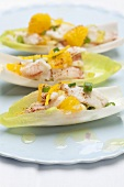 Chicory boats with a crab and orange salad