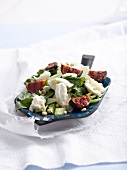 Fig and buffalo mozzarella salad with an orange and honey dressing