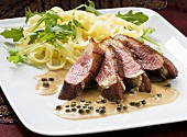 Duck breast with pepper sauce and tagliatelle