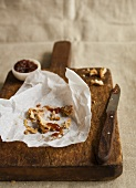 The remains of a pork pie and plum chutney on a chopping board