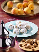 Oriental apricot balls with almonds and icing sugar
