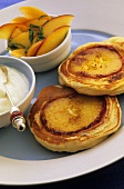 Pikelets with peaches